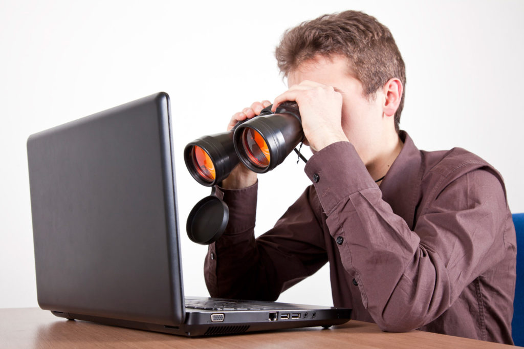 Person Using Binoculars With Laptop - Analyse Other Websites to Gain an Advantage